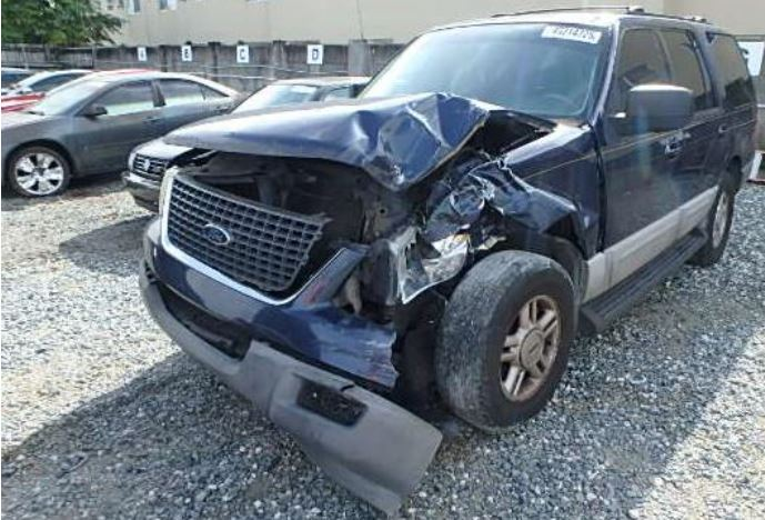 front crush damage to SUV at tow yard