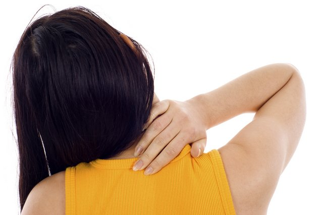 woman with her arm on the back of her neck