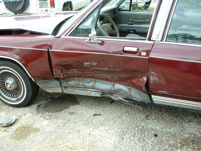 Left driver side and front damage to car