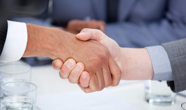 Attorney and adjuster shaking Handshake