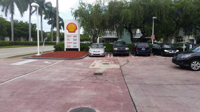 Cracks in floor surface outside a Coral Gables, Miami-Dade County, Florida gas station
