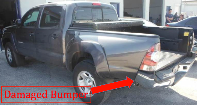 damaged rear bumper of pickup truck after getting rear ended by a car