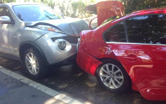 rear end crash: damage to front of car that crashed into the back of another