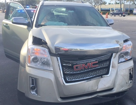 damage to front hood and fender of GMC SUV