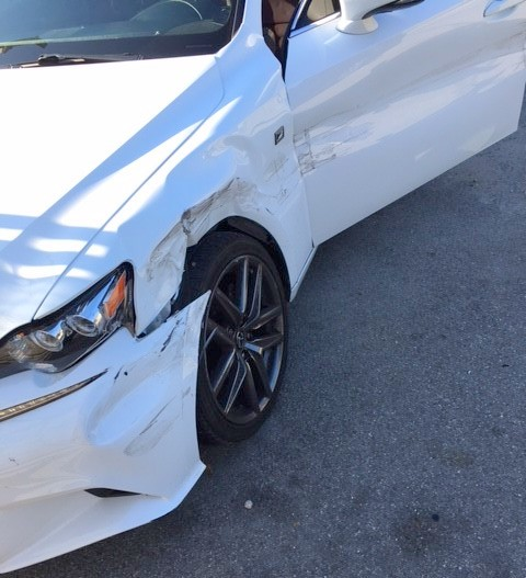 damage to the Uber car after a t-bone crash