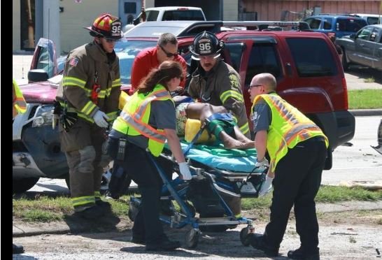 photo of lady on stretcher - online news