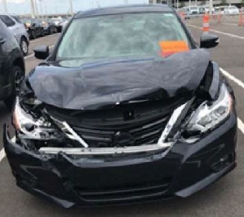 photo of damage to rental car front