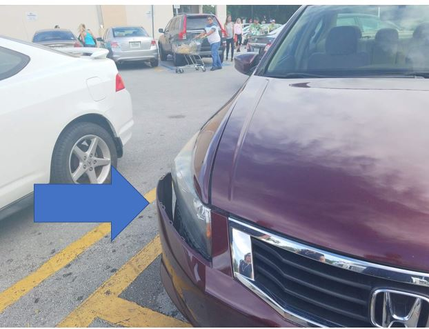 arrow pointing to car damage