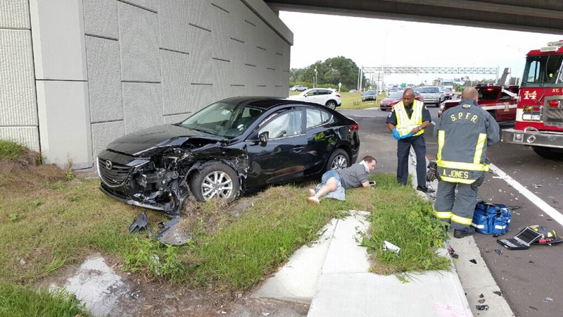 driver on the ground suffering a personal injury after car accident